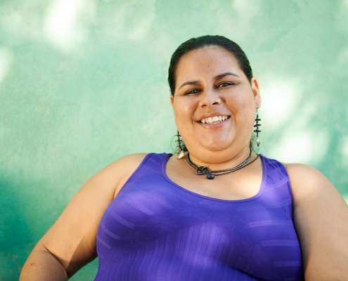Portrait of overweight hispanic woman looking at camera and smiling