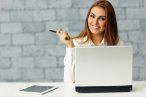 Confident relaxed businesswoman at her workplace in office