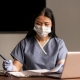 Asian doctor write documents. Infectious dangerous. Glove protection. Working hospital. Medicine concept. Virus. Test