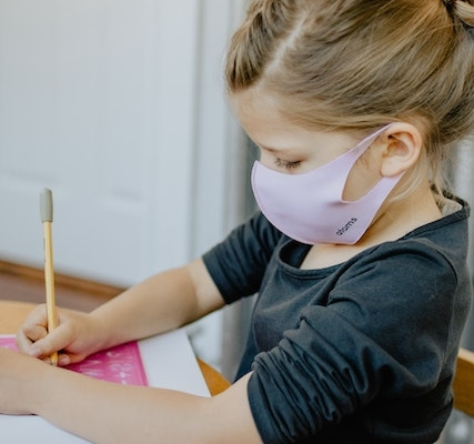 little girl mask writingkelly-sikkema-8RT0q9KdQHI-unsplash