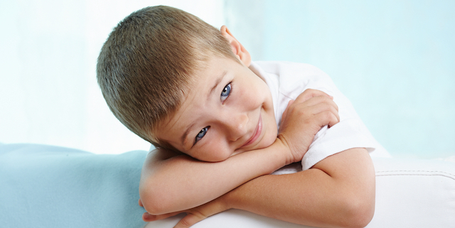 Little boy looking at camera with smile